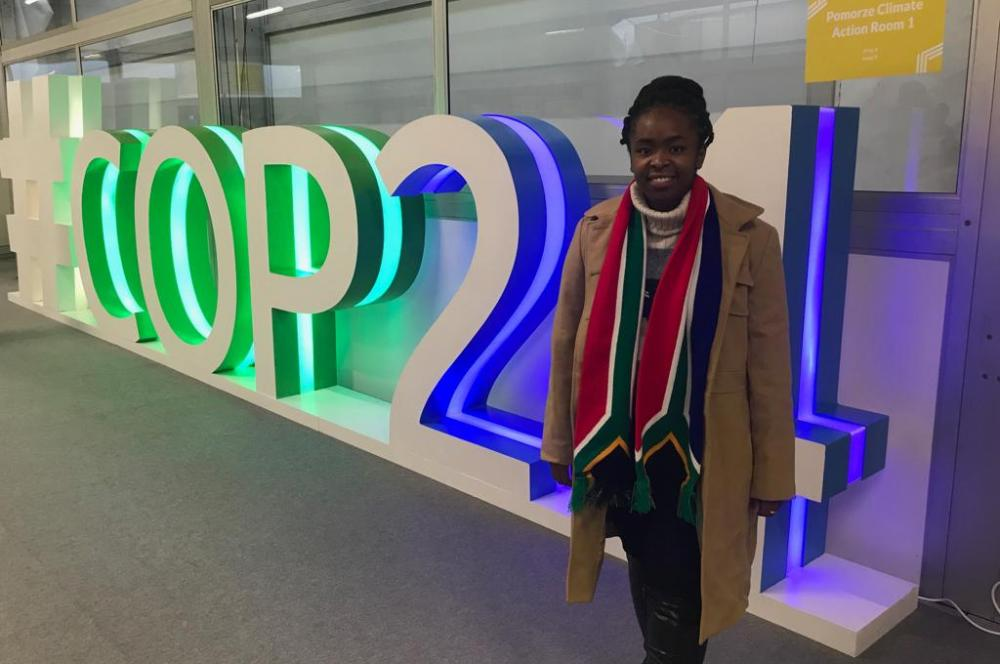 South African COP Youth Delegate, Ditebogo Lebea, poses in front of the COP sign