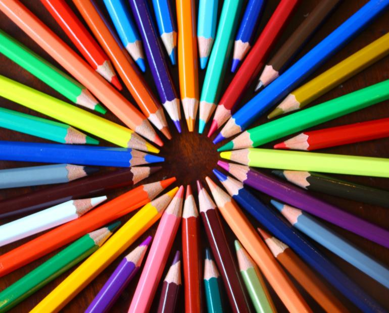 Colourful pencils arranged in a circle.