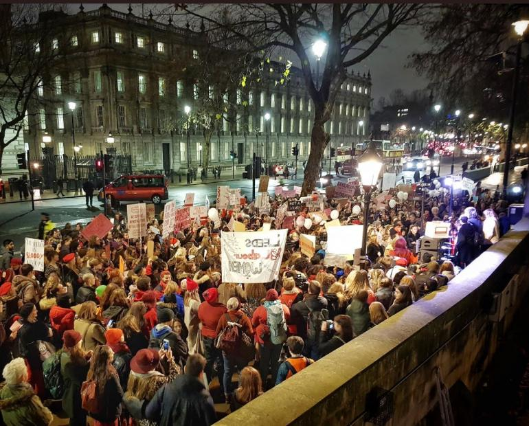 A photo of a march in the street.