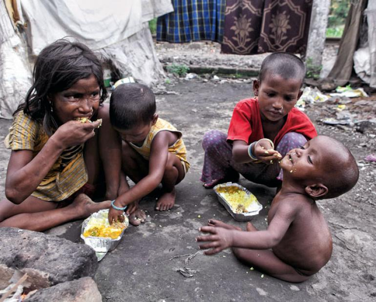 Children in the streets feeding each other