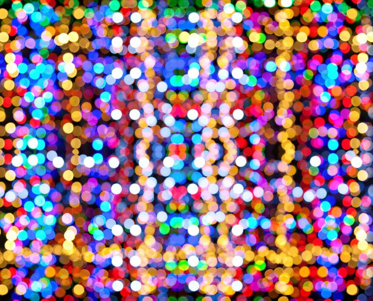 A blurred rainbow bokeh of Christmas lights.