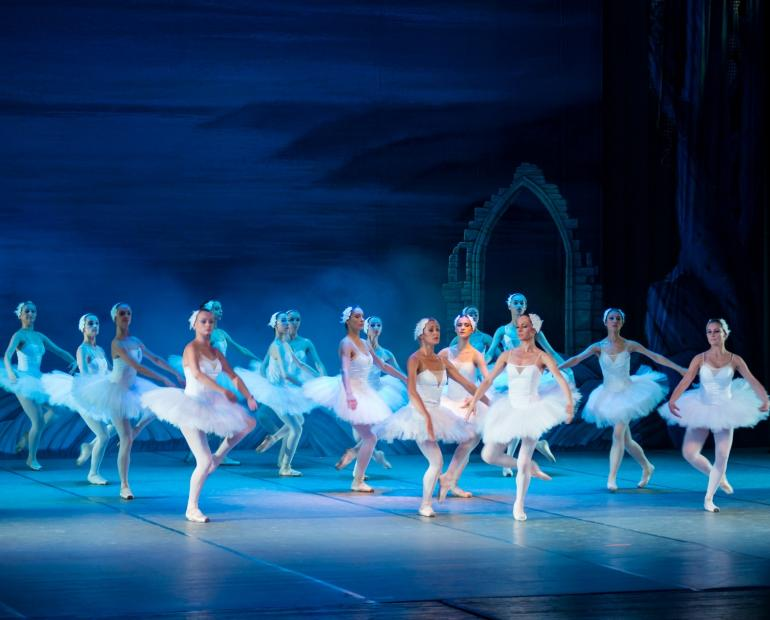 A group of ballerinas on a stage.
