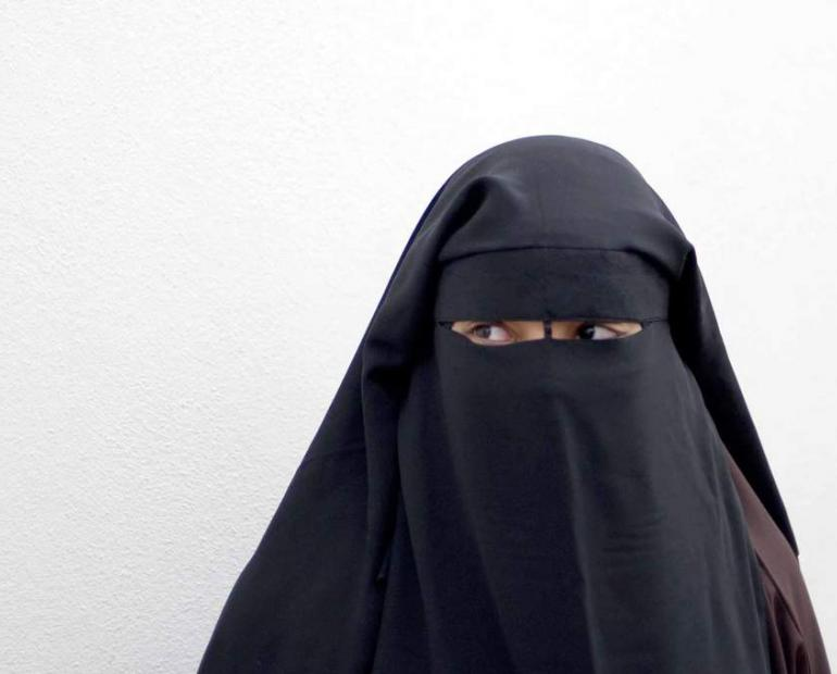 This is a lady wearing a burqa.