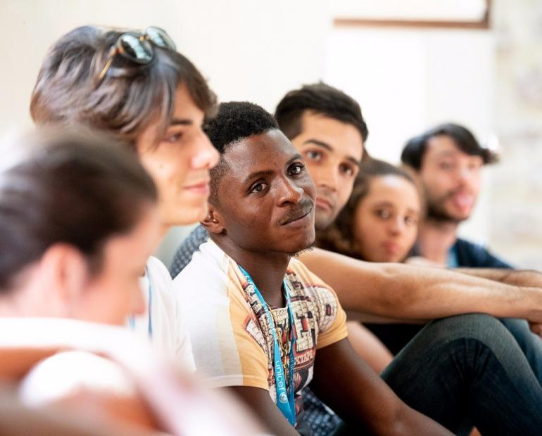 A group of young people at a a three-day event which gathered young UNICEF volunteers and young migrants and refugees.