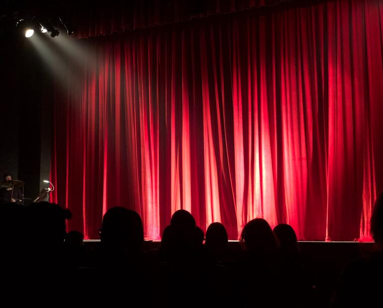A stage with a red curtain