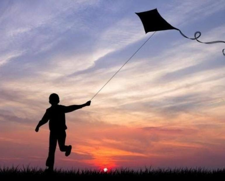 Kid playing kite
