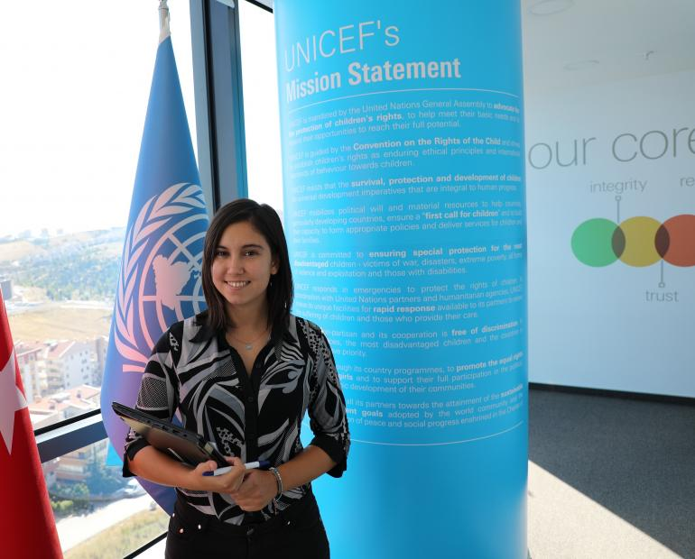 Yael in front of UNICEF flag