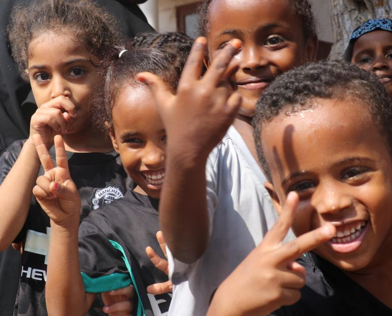 Children play outside their classrooms during a break time in urban Djibouti