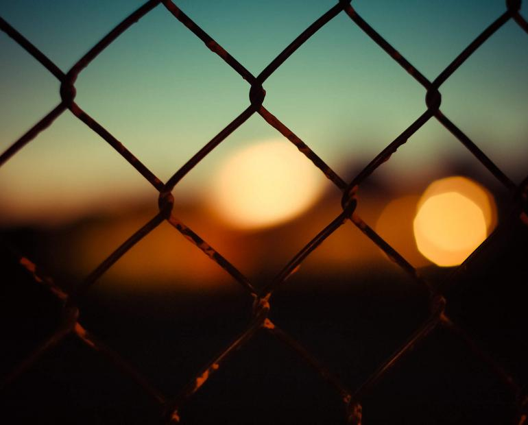 Blurred out hues behind a fence