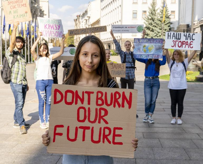 "Lorina holds a sign that says ""Don't burn our future"""