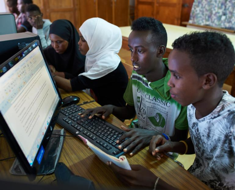 Two young people use a computer at a local community center in Quatier 4 in Djibouti City.