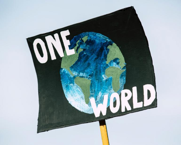 "A sign saying ""One World"""