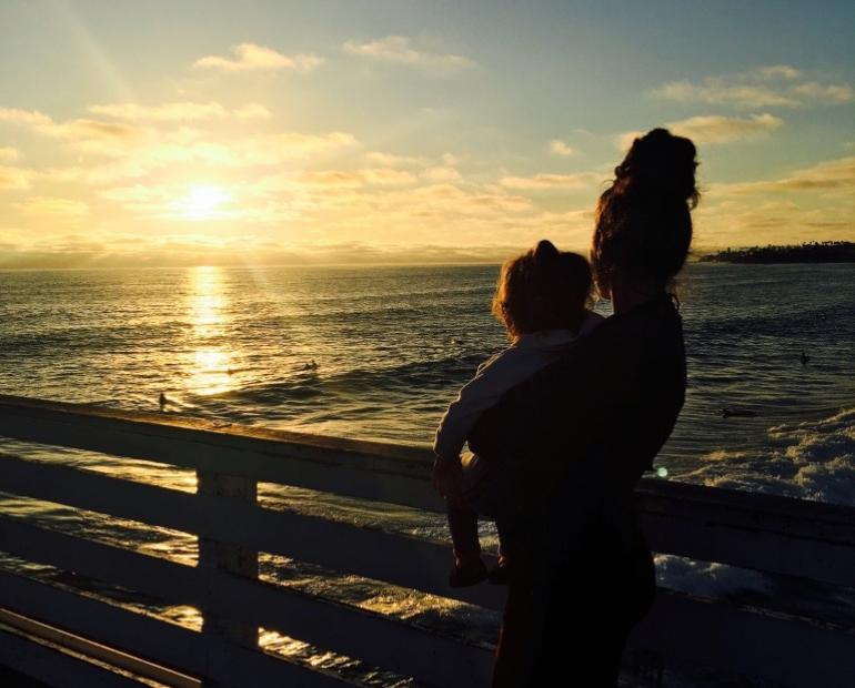 This is an image of my little cousin and I looking at the ocean. I was 17 and she was 3. We have a strong, loving bond like sisters. She's the little sister I've always dreamt of having.