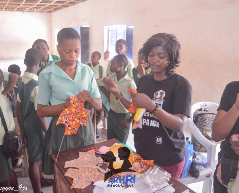 Teaching girls of Government Secondary school Odukpani how to make reusable pads