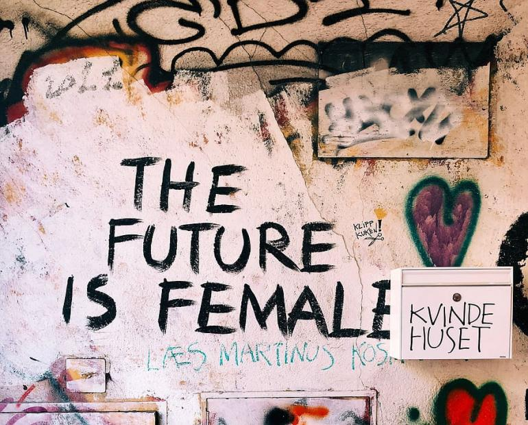 "Quote on Graffiti-Covered Wall: ""The Future is Female"""