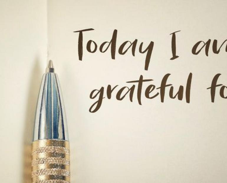 "Book with pen and writing ""Today I am grateful"""