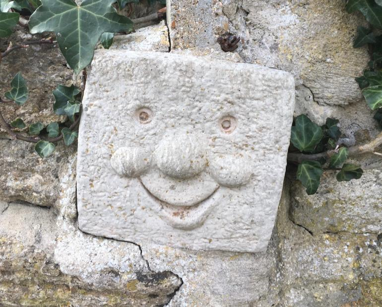 Smiling rock gargoyle thing