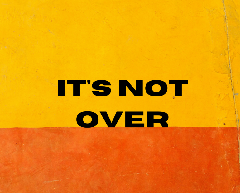 "The words ""It's Not Over"" on a yellow and orange background"