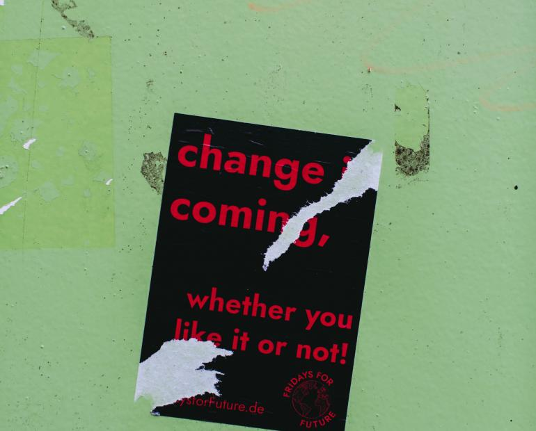 """change is coming, whether you like it or not"" red text on black on pale"