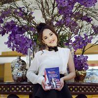 Alma Dhea with her book