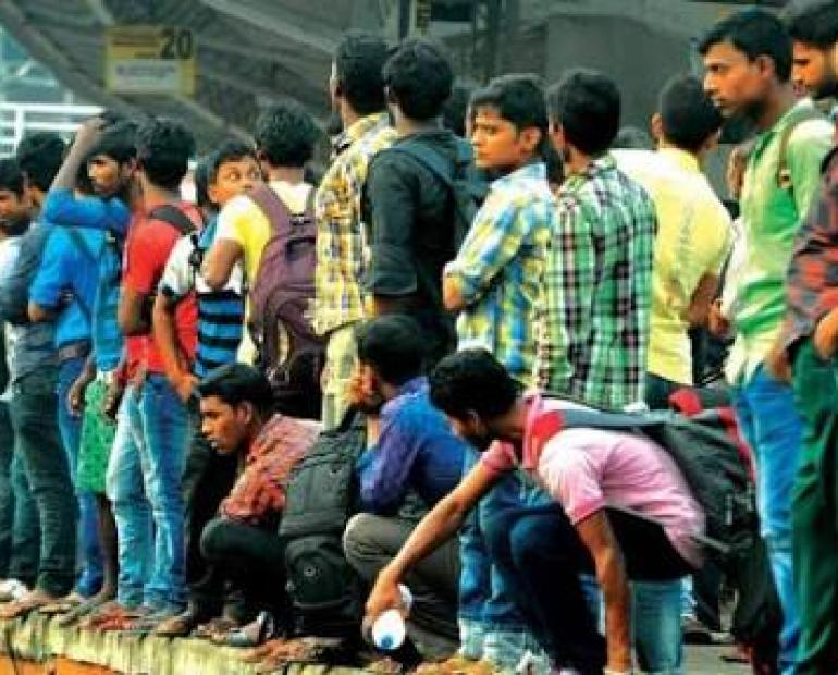Bihari youths standing on a railway platform in Gujarat