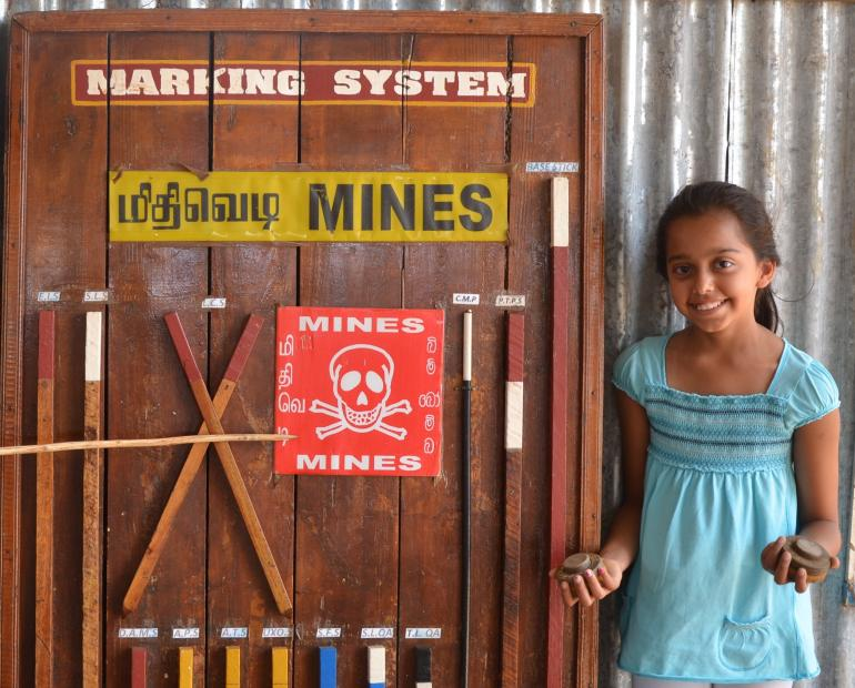 Holding mines at Batticaloa Beach, Sri Lanka