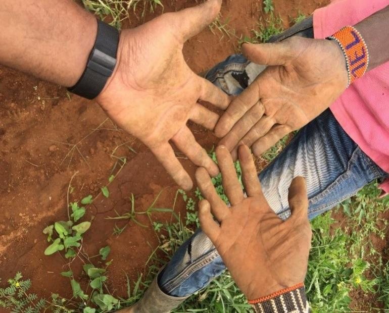 Hands with soil on them