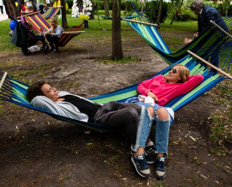 Dany Stolbunov, 20, and his friend, Anya, 19, relax on a hammock in Shevchenko Park