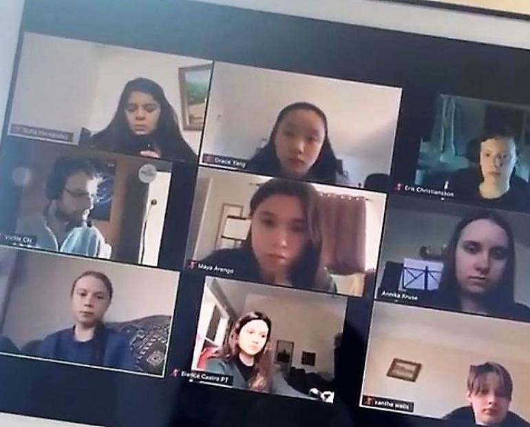 Sofía (21) in a zoom call with her climate activists friends planning activities for Earth Day and Online Strike.