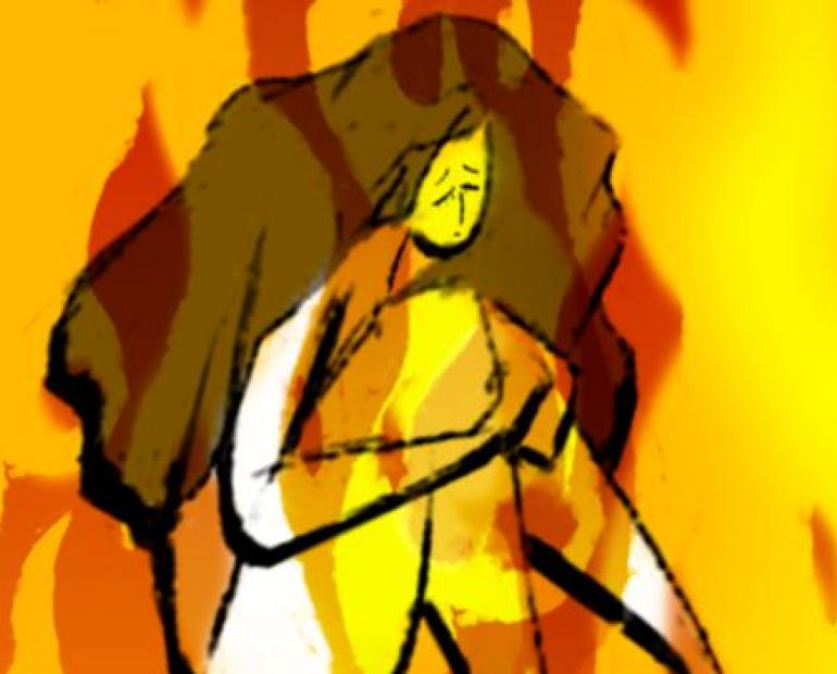 A scared woman with a fire background