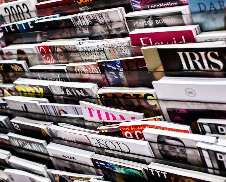 A magazine rack of a myriad of magazines