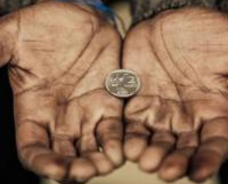 A coin in Poor's hand.