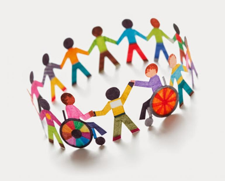 A circle of students, abled and disabled