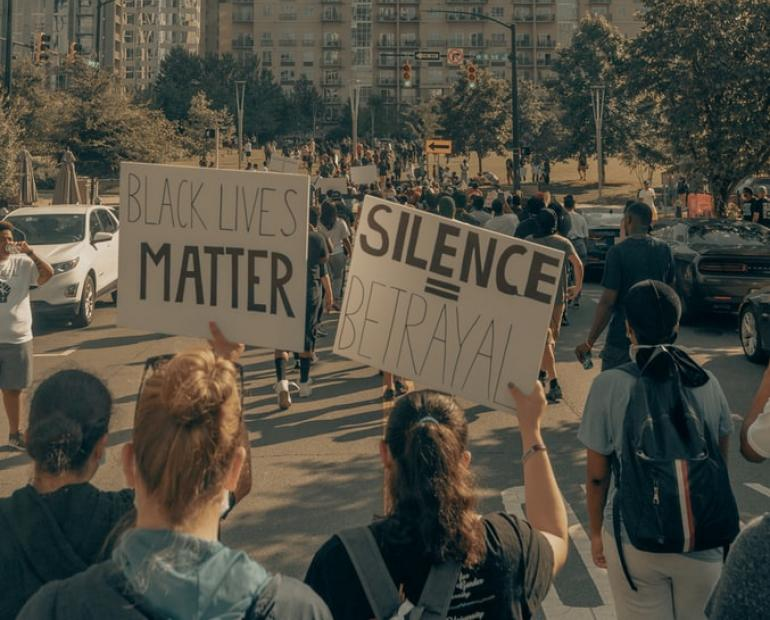 /People protesting: Silence is betrayal. Black Lives Matter./