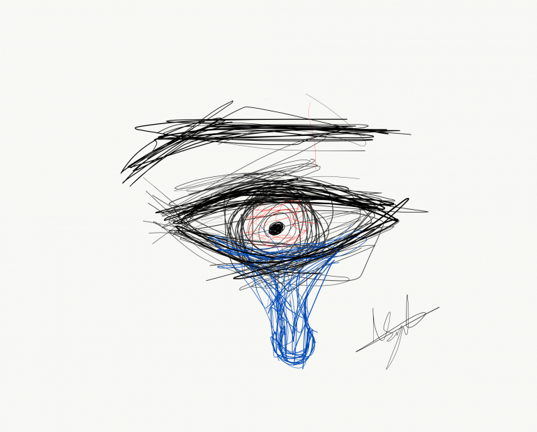 The eye of a man with a tear drop falling out.