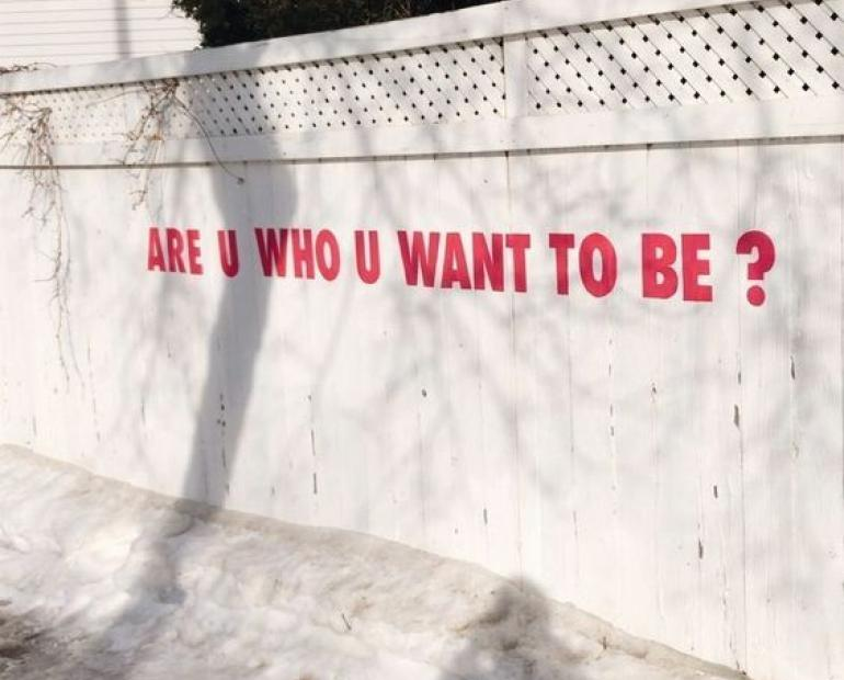 "a wall that has the words ""are you who you want to be"""