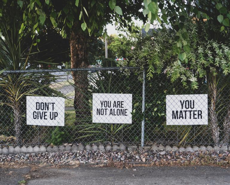 "Signs that say ""Don't give up"", ""You are not alone"", ""You matter"""