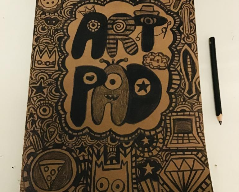 This is my art pad. The cover was plain cardboard at first, thus I decided to decorate it with doodles I did.