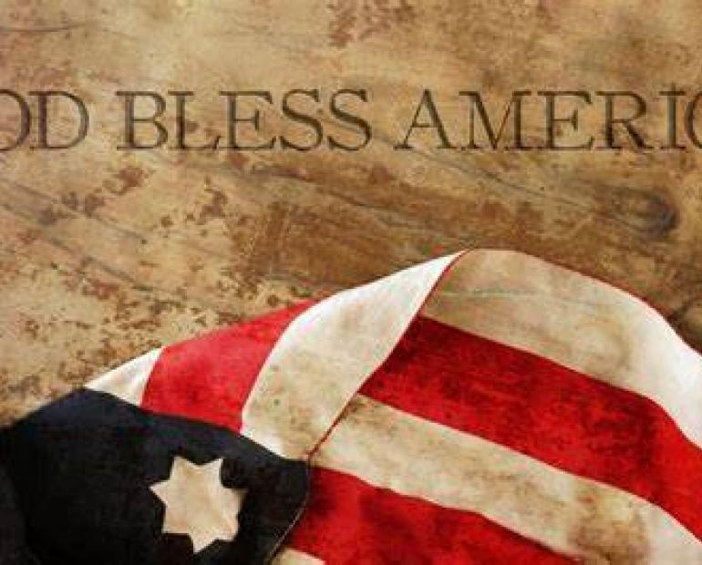 "picture of American flag with the words ""God Bless America"" placed on top of it."