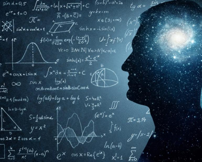Photo edit of blackboard filed with physics problem with a man whose mind is set on exploring the universe.