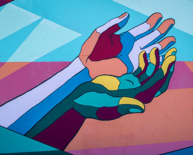 Abstract of two hands next to each other