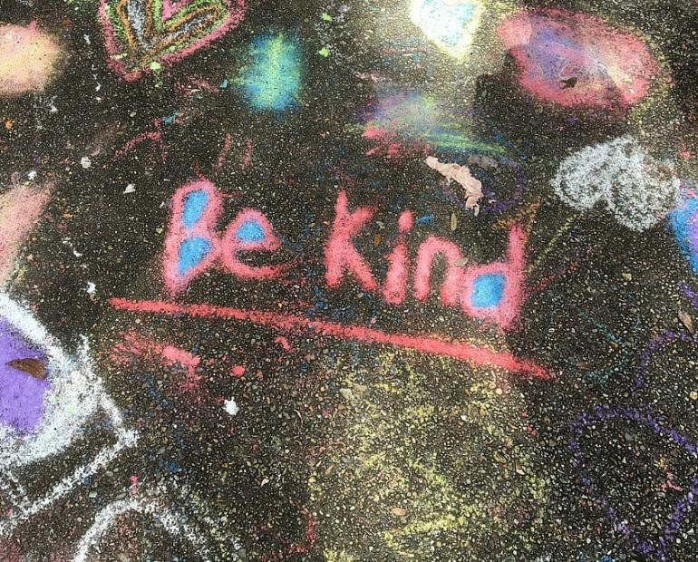 """Be Kind"" written in chalk"