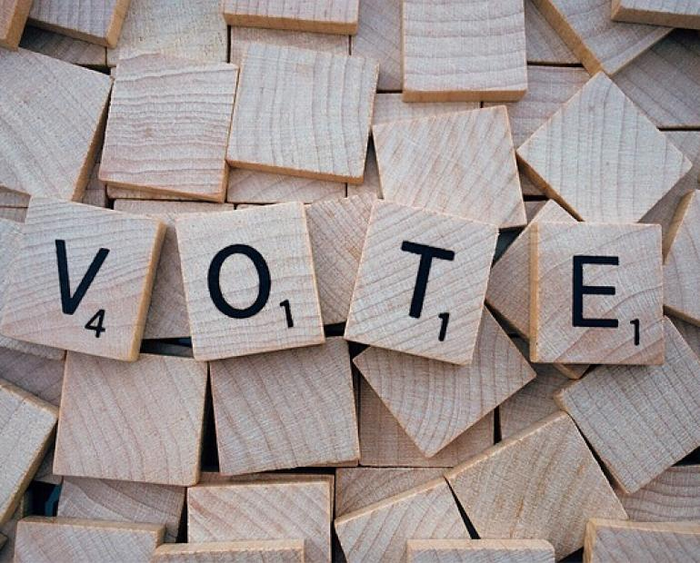 The word vote written using block letters