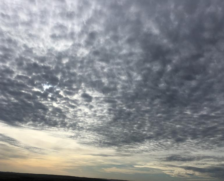 An image of a moody sky with mottled clouds
