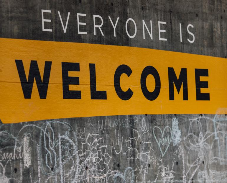 "A wall that illustrates the text ""Everyone is Welcome"""