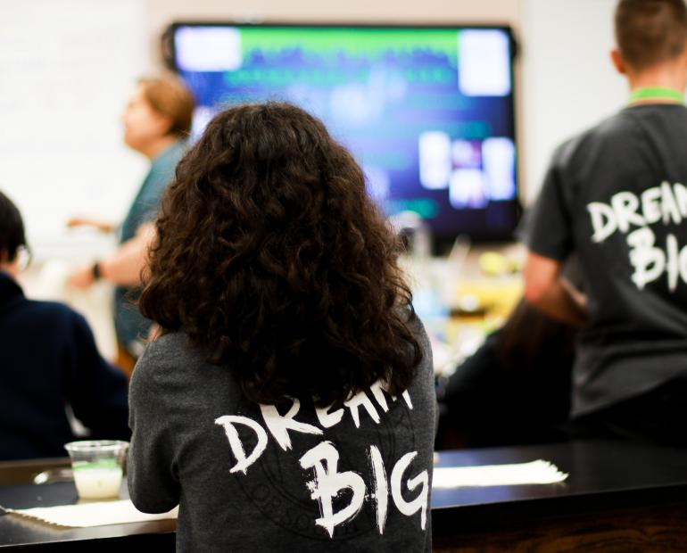 Photo of a student wearing a t-shirt with the caption dream big