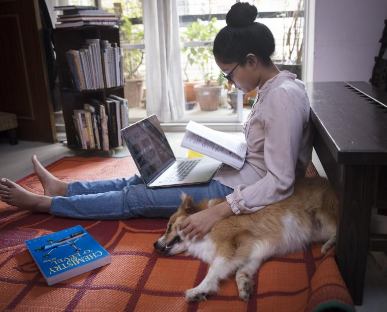 Agnidrohee Spondon, a grade 10 student from Bangladesh, aged 17 years doing self-study at home during quarantine to keep up her academic progress.
