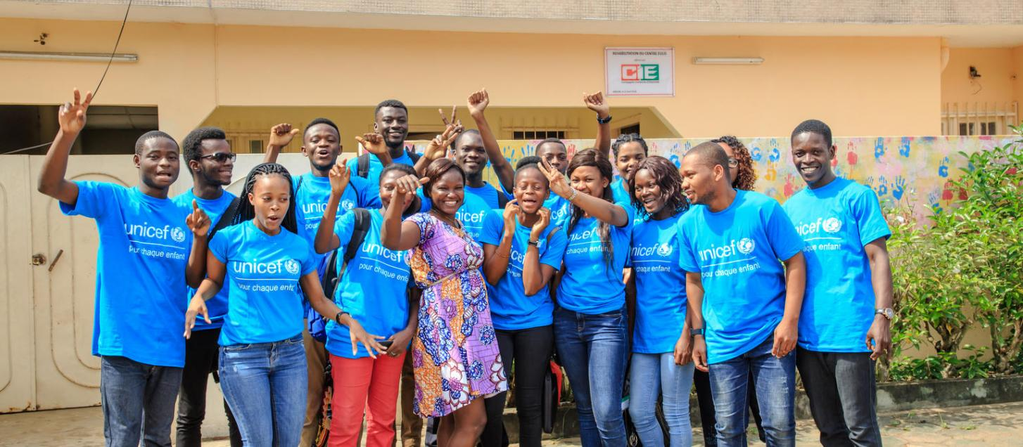 Youth participants pose for a photo outside a community library