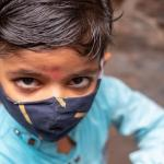 Child in India wearing a mask