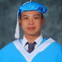 A boy wearing graduation gown and cap.